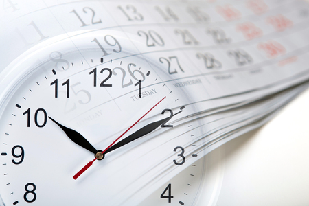 wall calendar with the number of days and clock closeup