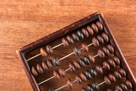 antique abacus on a wooden table as a background close up