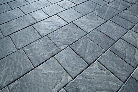 city rectangular gray paving tiles close up