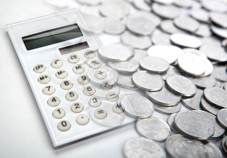big white calculator with russian ruble coins close up Stock Photo