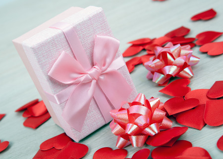 pink gift box with textile heart shapes close up
