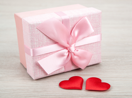 pink gift box with two textile heart shapes  close up