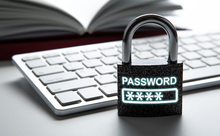 padlock with network password with a computer keyboard close up