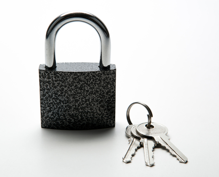 durable padlock with keychain on white close up