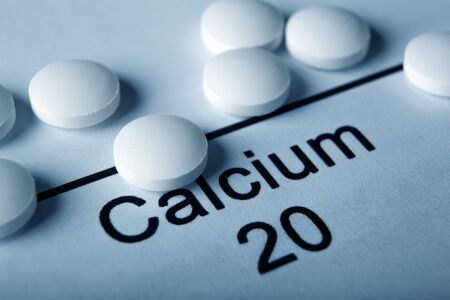 white tablets with calcium and the inscription of the chemical element Calcium close up