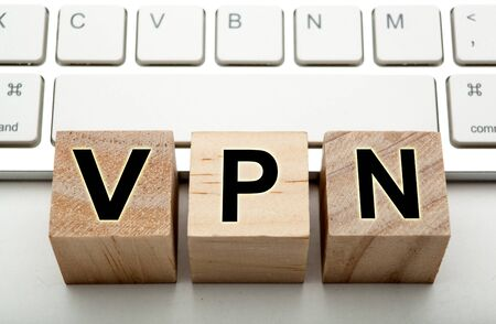 three wooden cubes with inscription VPN with the computer keyboard close up 写真素材