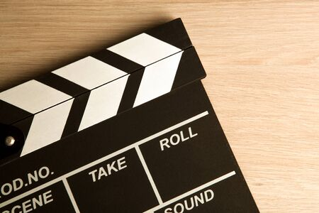 movie clapper on a wooden background