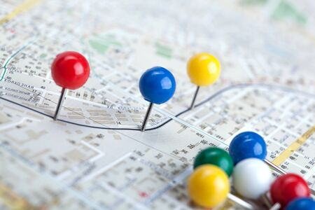 topographic map with colored needles pushpins