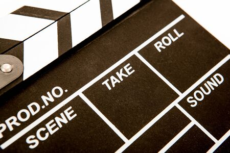 movie clapper with white inscriptions close up