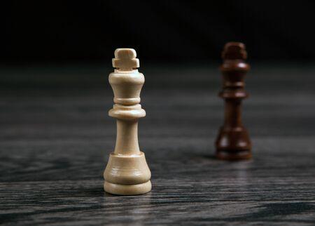 chess kings on wooden background closeup Фото со стока