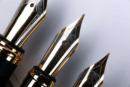 gold plated fountain pens closeup on the table