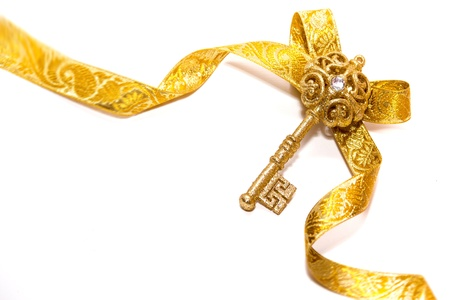 golden key: shining symbol of a new life, isolated on a white background