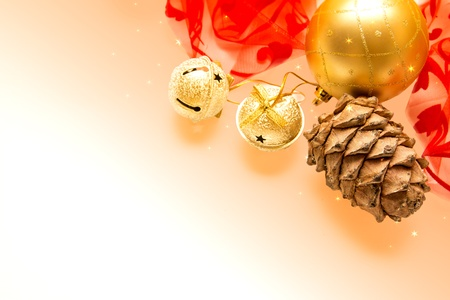 with bells, cedar cone, golden ball and red ribbons photo
