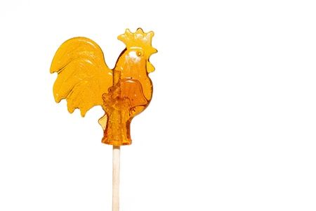 Sugar cockerel on a stick isolated on white background Stock Photo - 16697687