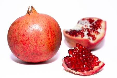 peal: Open red pomegranate with seeds isolated on white background