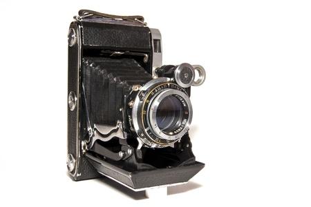 photocamera: Old-time rusty photo-camera isolated on white background