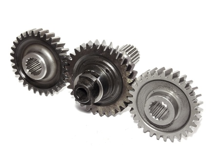 interplay: Three gear wheels isolated on white background
