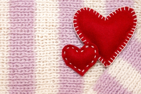Valentines Day concept. Knitted wool jersey with two red handmade hearts photo