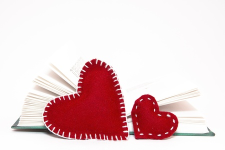Two red heart with open book isolated on white background Stock Photo - 16770406