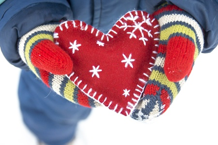 Christmas concept. Child hold handmade heart Stock Photo