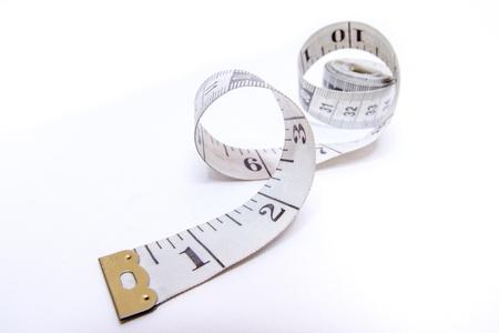 tailor measure: Nastro di misura isolato su sfondo bianco Archivio Fotografico