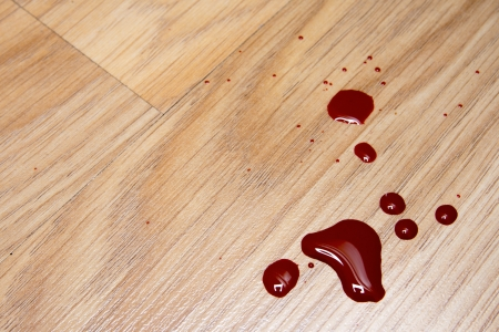 Drops of blood on laminate floor texture Stock Photo