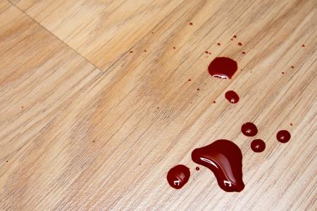 Drops of blood on laminate floor texture Stock Photo