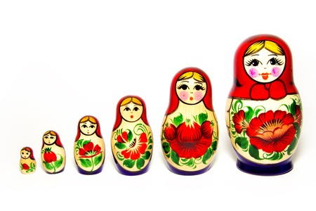 Russian Babushka nesting dolls in row, isolated on white background. photo