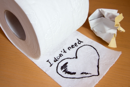 Note with heart on toilet paper, no love concept Stock Photo - 17588221