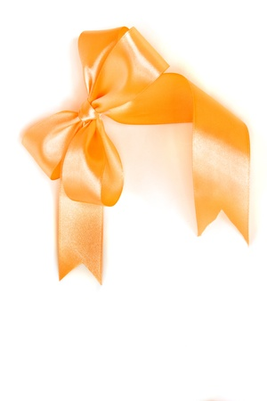 Gift satin orange ribbon bow isolated on white background photo
