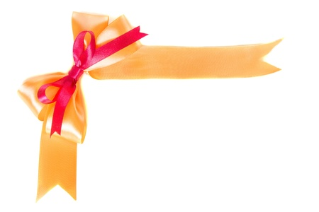 Gift satin orange ribbon with bow isolated on white background photo