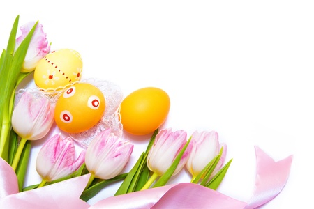 Easter border made of painted Easter eggs, pink tulips and silk ribbon isolated on white background photo