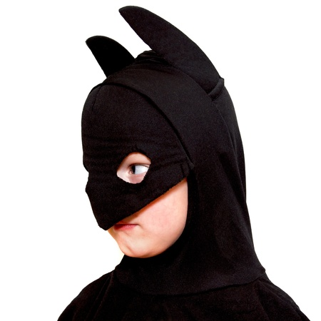 batman: Young boy in batman costume isolated on white background Stock Photo