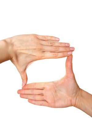 cinematographer: Female hands making frame isolated on white background.