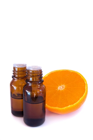 with orange and white body: Aromatic essential oil and fresh orange isolated on white background.