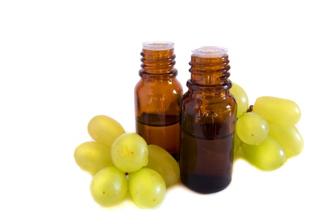 Grape seed oil isolated on white background photo