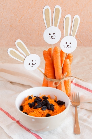 Grated carrot with raisin and paper rabbits Stock Photo - 18082316