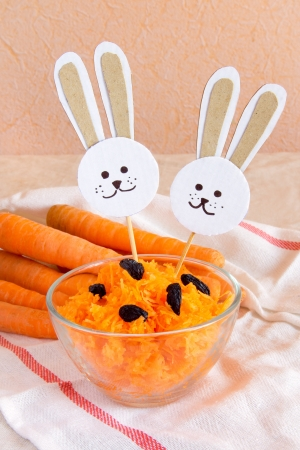 Grated carrot with raisin and paper rabbits Stock Photo - 18082303