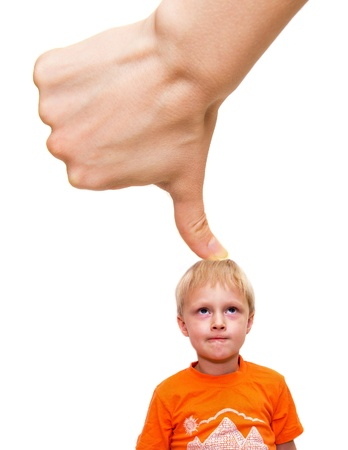 Big thumb (hand) pushing child, isolated on white. Stress and abuse concept.