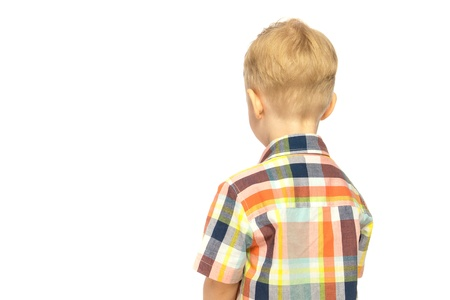 punished: Little blond boy (child) upset, offened and turned his back isolated on white background. Stock Photo