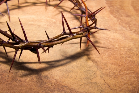 Crown of thorns over brown marble background, copy spase. Christian concept of suffering. photo