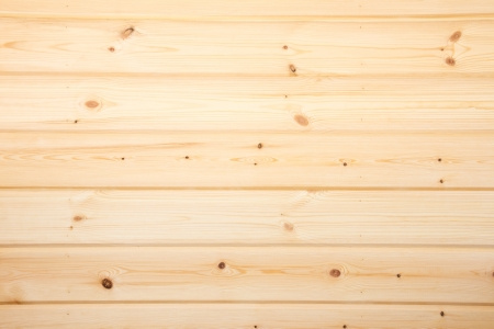 Wooden texture (surface, background) close up. Beige pine planks horizontal.
