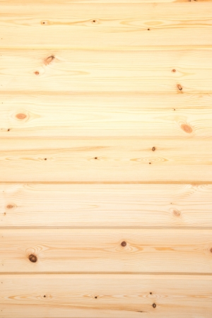 Wooden texture (surface, background) close up. Beige pine planks vertical. photo
