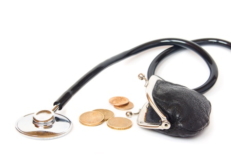 Stethoscope, coins and open vintage wallet isolated on white background. Medical budget,  healthcare value, economy concept. photo