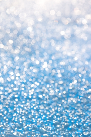 Ice crystals glittering blue texture, christmas winter vertical background. Stock Photo