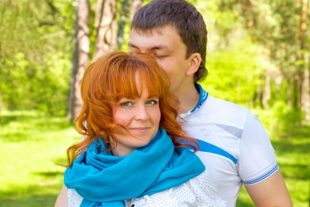 Outdoor happy beautiful sensual couple in love close up posing in spring photo
