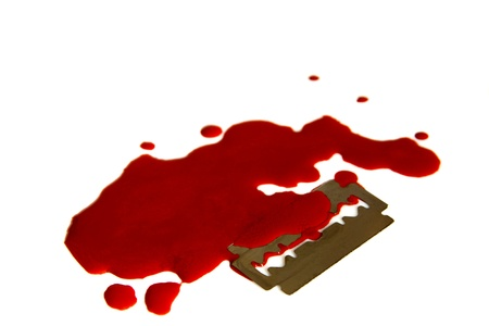 razor blade: Pool (puddle, stains, droplets) of blood and razor blade isolated on white background close up. Despair and hopeless concept. Stock Photo