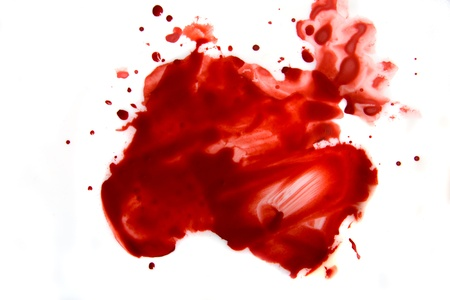 Bloeduitstrijkje druppeltjes (vlekken, splatter) islated op witte achtergrond close-up