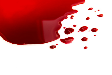 Blood pool (puddle) isolated on white background close up, horizontal, copy space photo