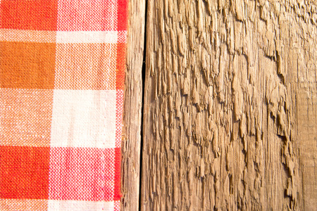 Checkered napkin on rustic wooden bacground (table, texture) photo